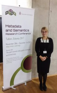 Sam Grabus standing with the conference banner at MTSR 2017